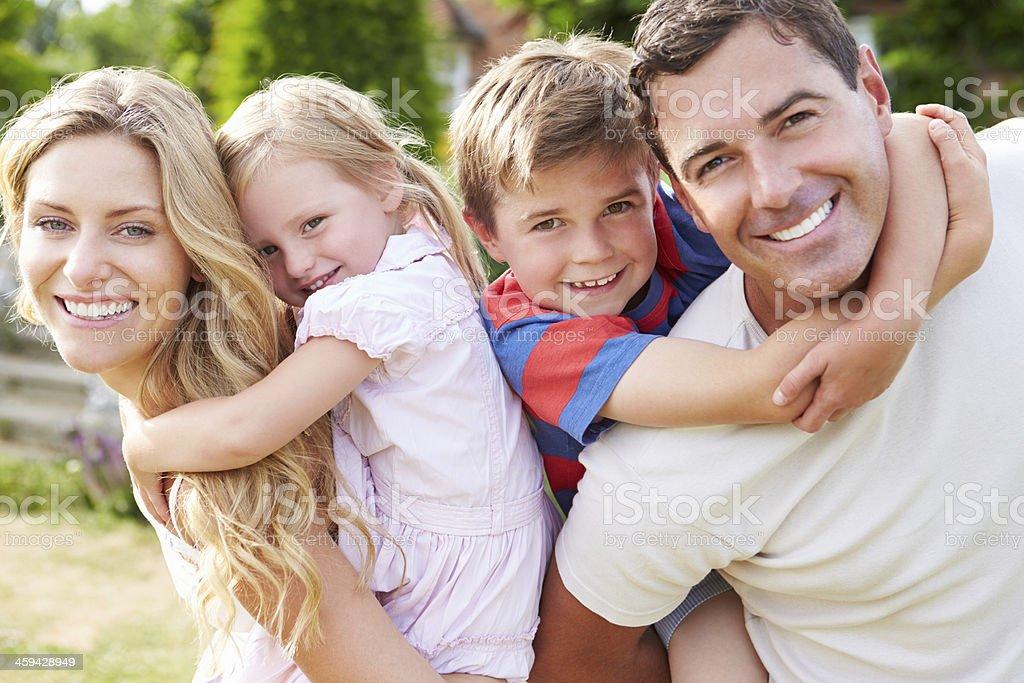 Portrait of smiling family in garden stock photo