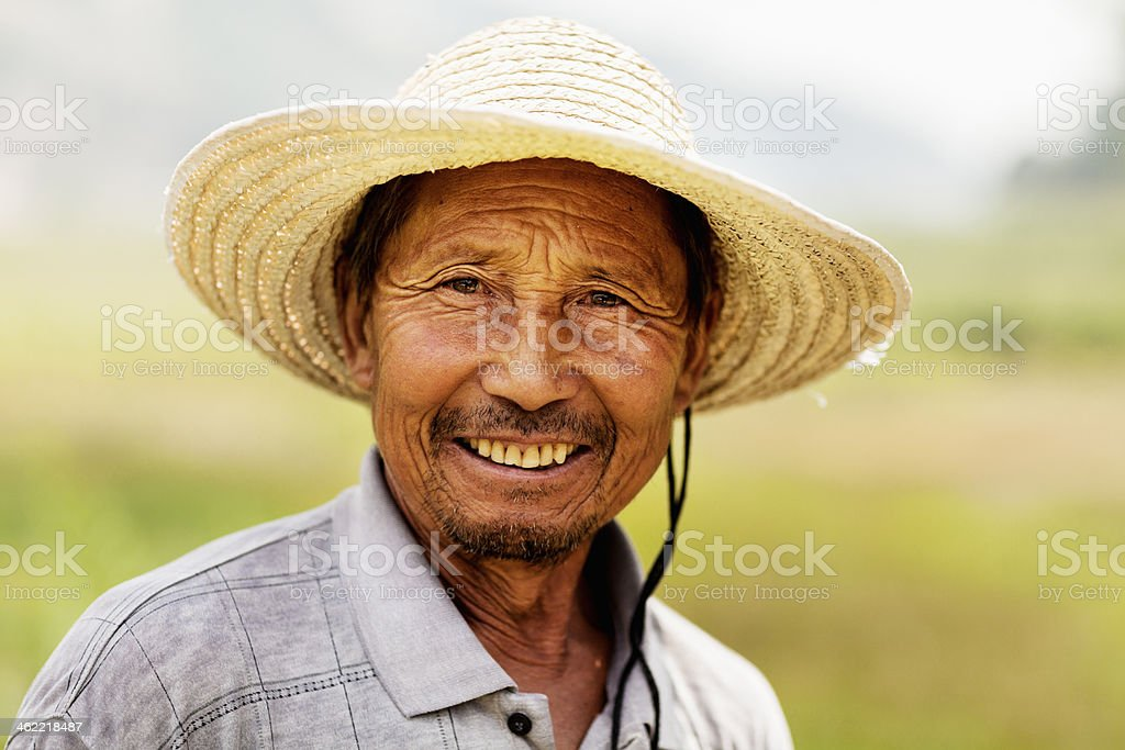 Portrait of smiling farmer, rural China, Shanxi Province stock photo