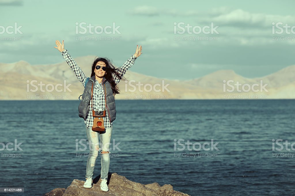 Portrait of smiling female with vintage camera discovering stock photo