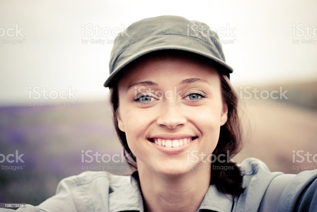 portrait of smiling girl in a headdress royalty-free stock photo