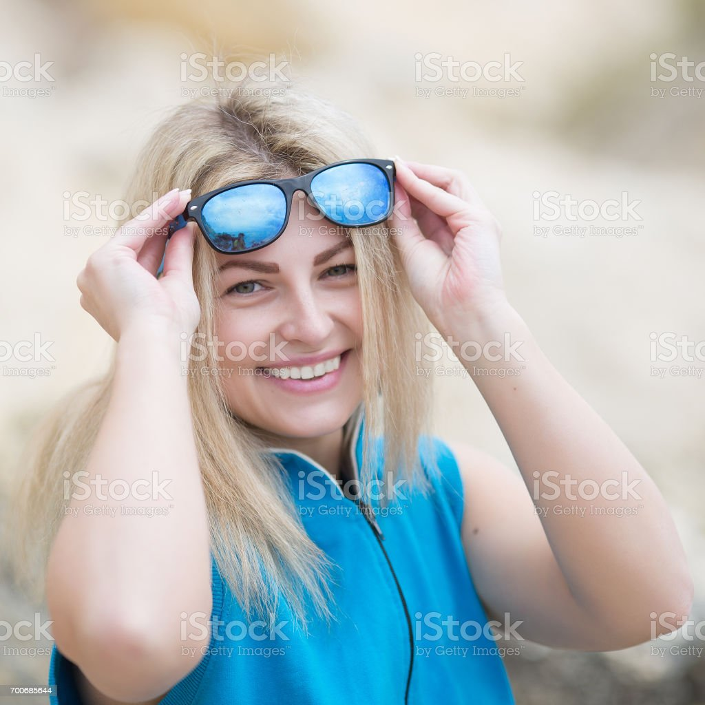 Portrait of smiling girl in blue sportswear on open air stock photo