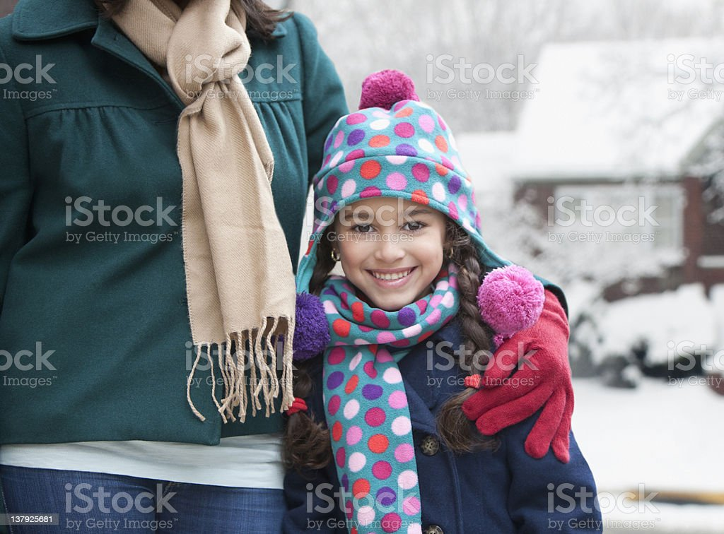 Portrait of smiling girl in winter stock photo