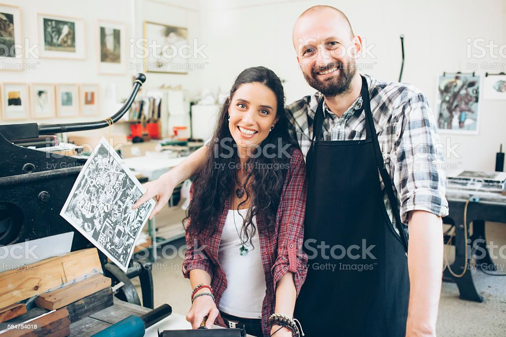 Portrait of smiling lithograph workers at printing house stock photo