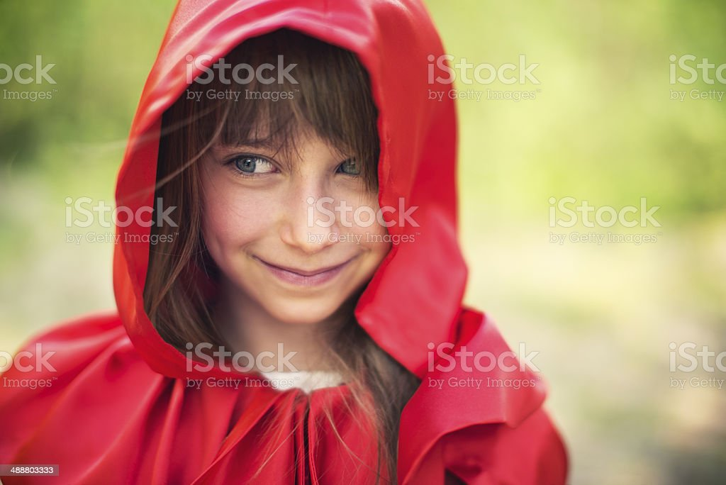 Portrait of smiling Little Red Riding Hood royalty-free stock photo