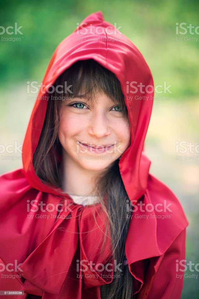 Portrait of smiling Little Red Riding Hood stock photo