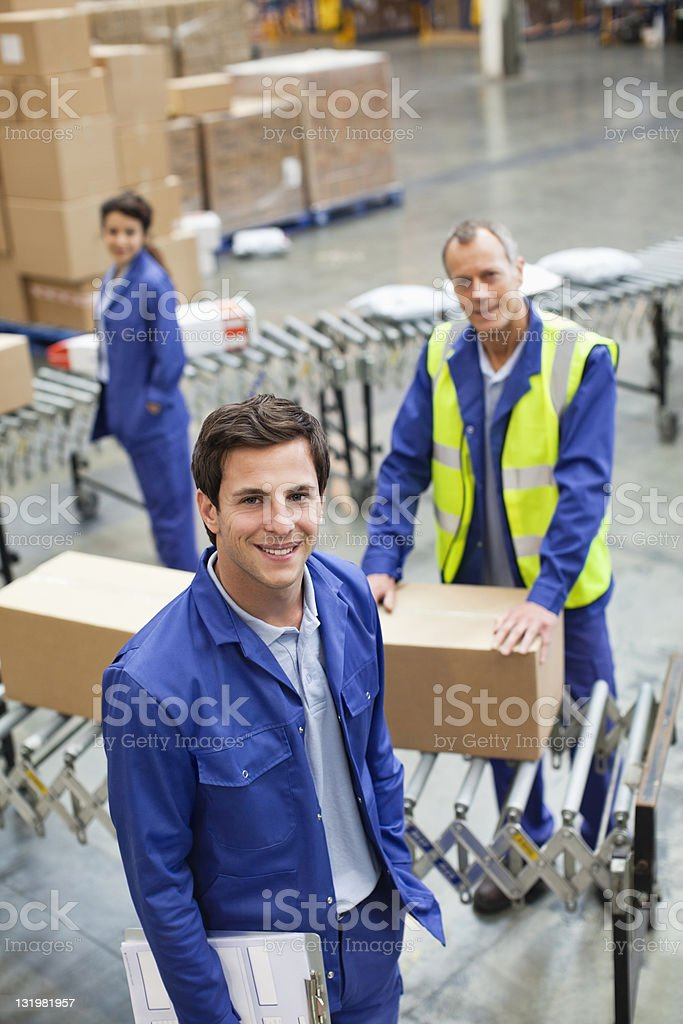 Portrait of smiling male worker with colleagues in background royalty-free stock photo