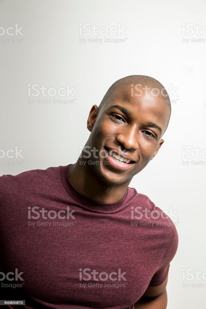 Portrait of smiling man against white background stock photo
