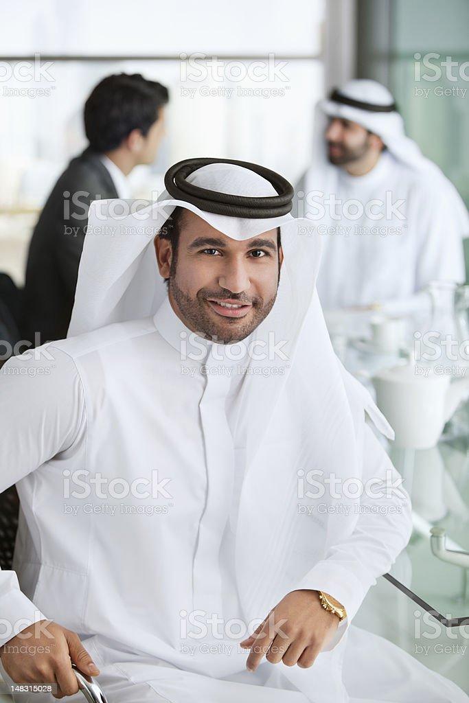 Portrait of smiling man in kaffiyeh royalty-free stock photo