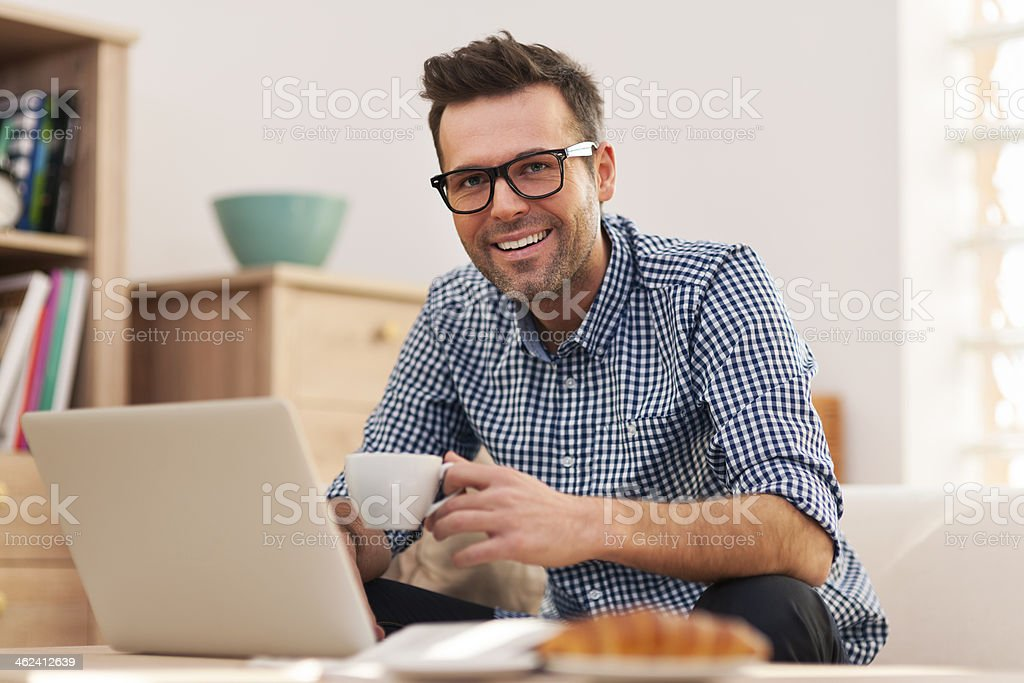 Portrait of smiling man working at home stock photo