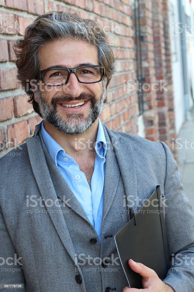 Portrait of smiling mature posh man stock photo
