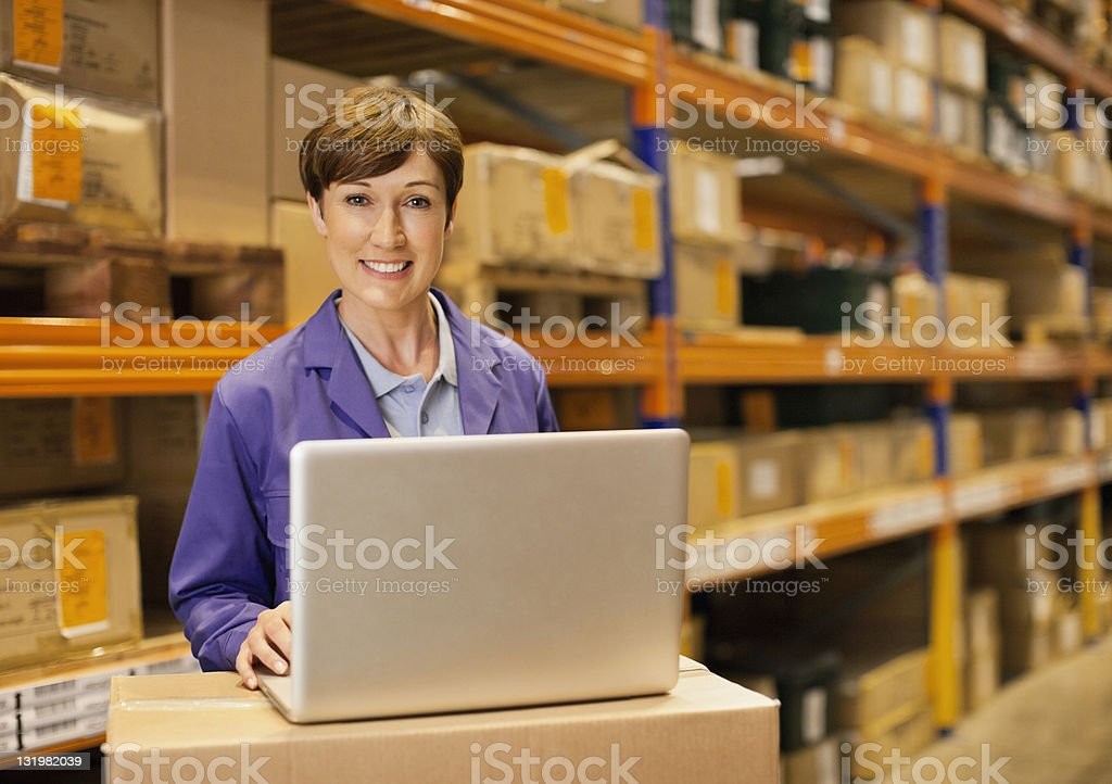 Portrait of smiling mature woman with laptop stock photo