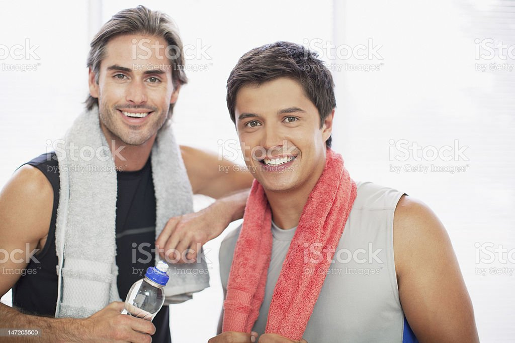 Portrait of smiling men in gymnasium royalty-free stock photo