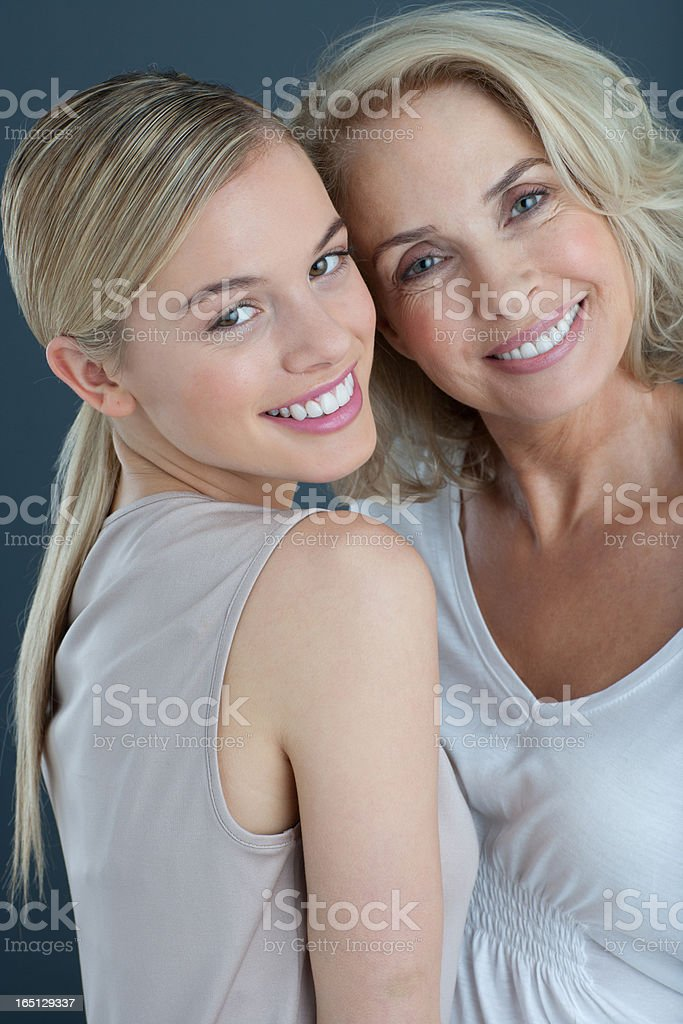 Portrait of smiling mother and daughter stock photo