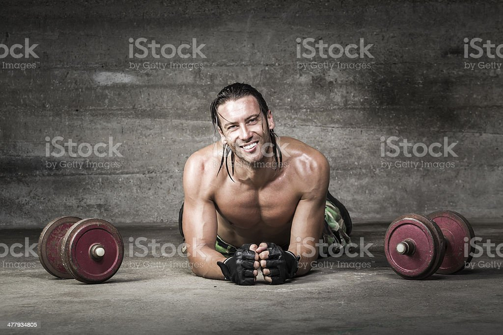 portrait of smiling muscle athlete royalty-free stock photo