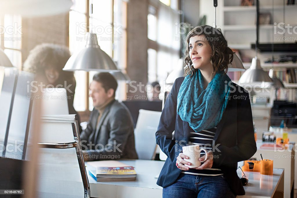 Portrait of smiling office worker relax having a coffee stock photo