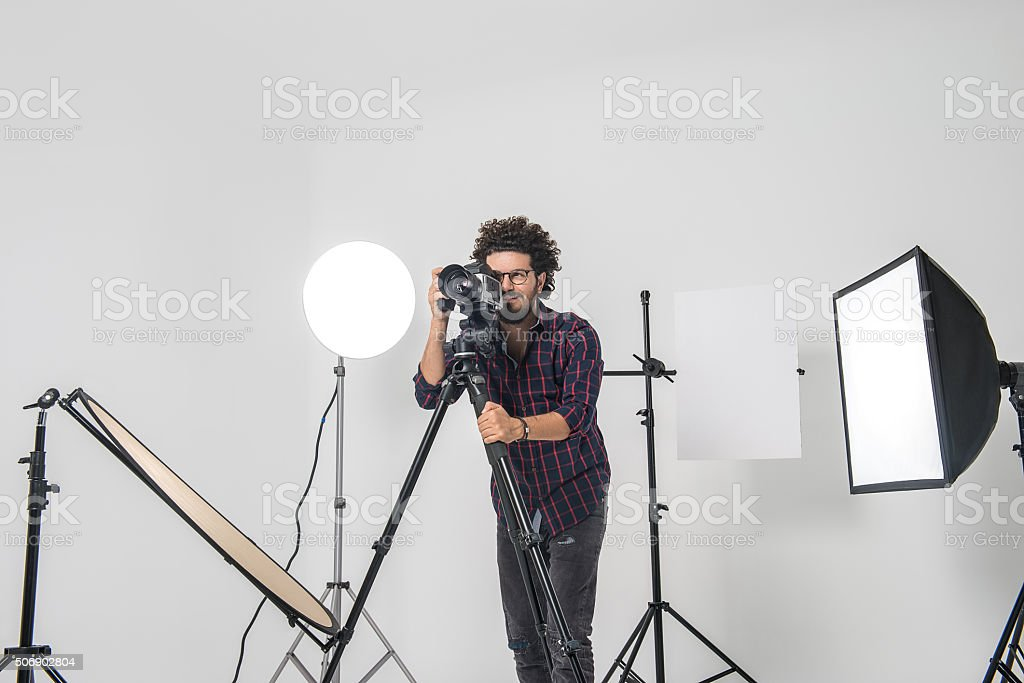 Portrait of smiling photographer with medium format camera stock photo