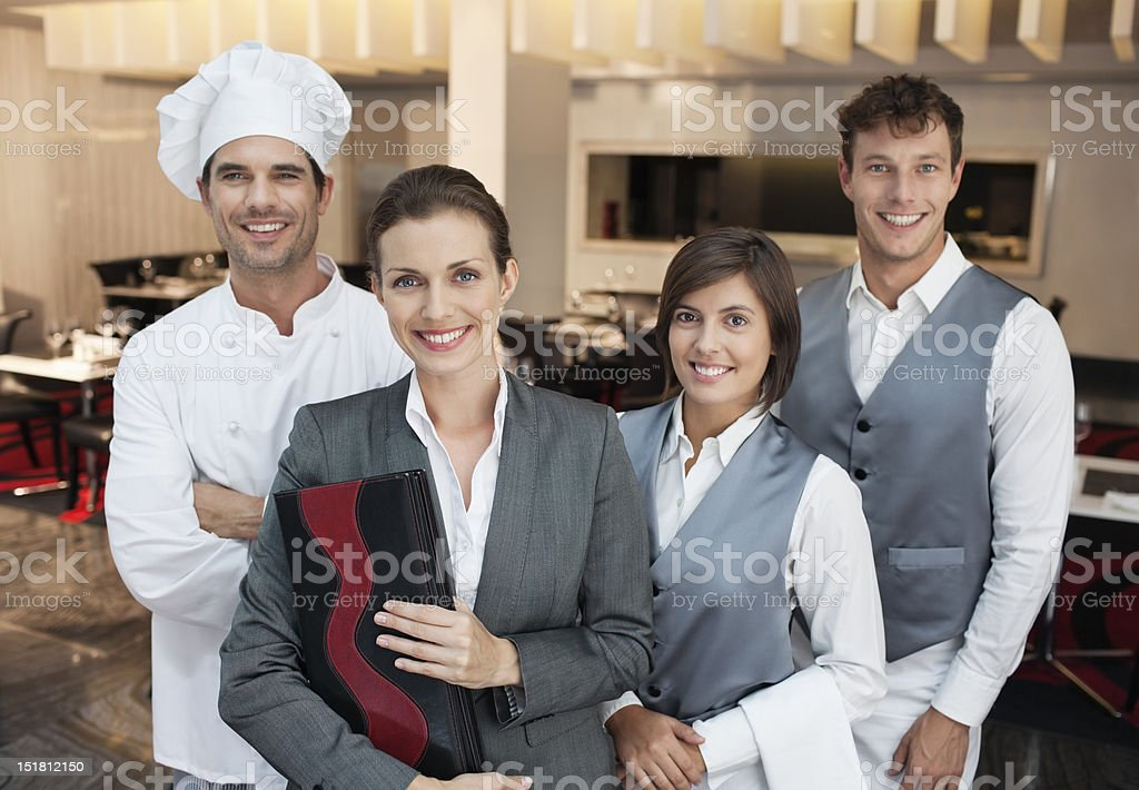 Portrait of smiling restaurant employees stock photo