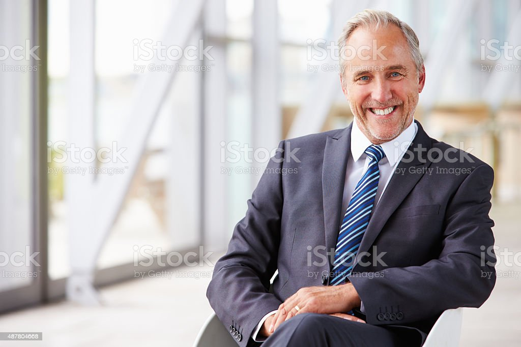 Portrait of smiling senior corporate businessman, waist up stock photo