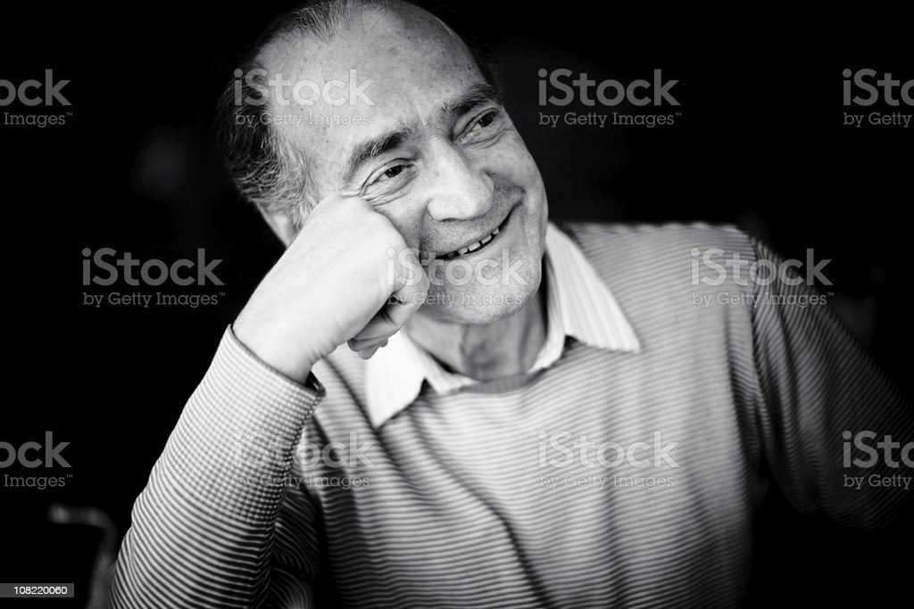 Portrait of Smiling Senior Man Resting Head on Hand royalty-free stock photo
