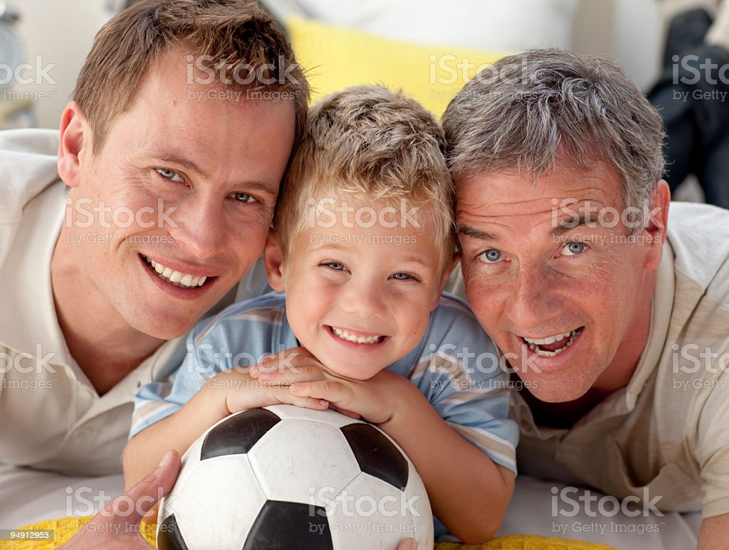 Portrait of smiling son, father and grandfather on bed royalty-free stock photo