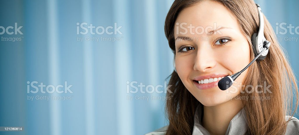 Portrait of smiling support phone operator in headset stock photo