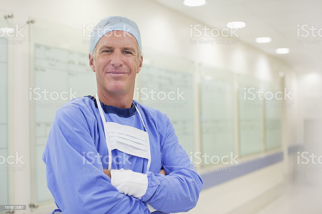Portrait of smiling surgeon in hospital corridor stock photo