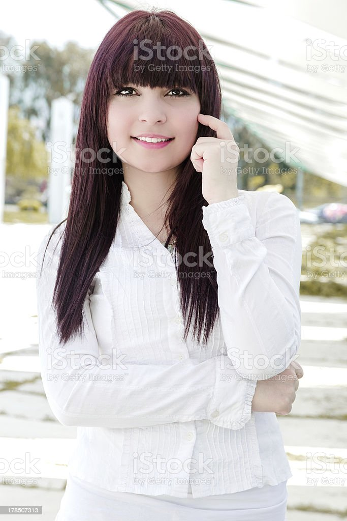 Portrait of smiling teenage girl royalty-free stock photo
