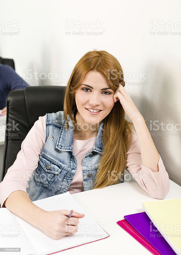 Portrait of smiling teenage student royalty-free stock photo