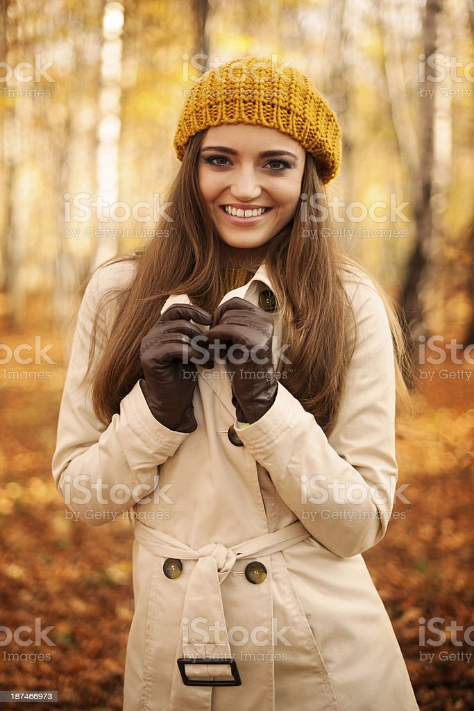 Portrait of smiling woman at autumn stock photo