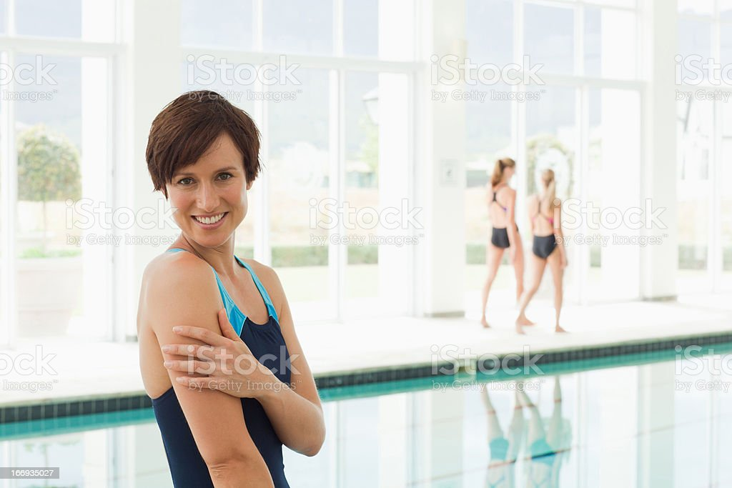 Portrait of smiling woman at swimming pool royalty-free stock photo