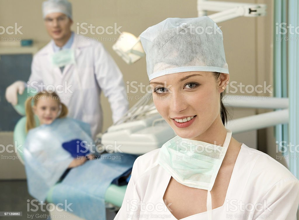 Portrait of smiling woman in a dental surgery royalty-free stock photo
