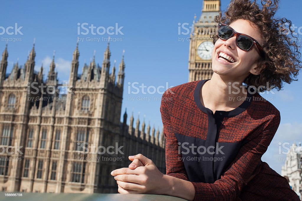 Portrait of smiling woman  in front of Big Ben clocktower royalty-free stock photo