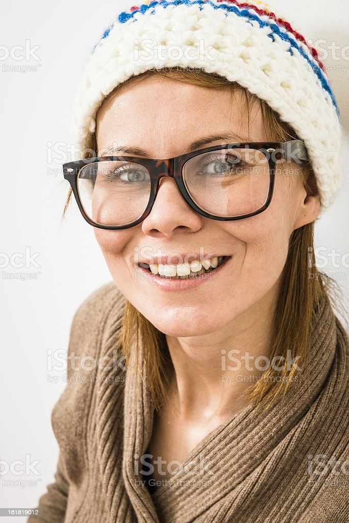 Portrait of smiling woman in glasses, winter cap on head royalty-free stock photo