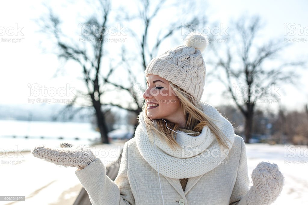 Portrait of smiling woman in snow stock photo