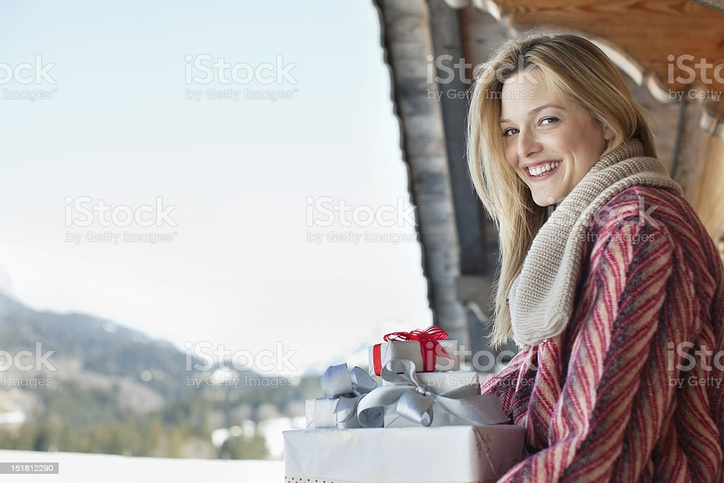 Portrait of smiling woman with Christmas gifts royalty-free stock photo