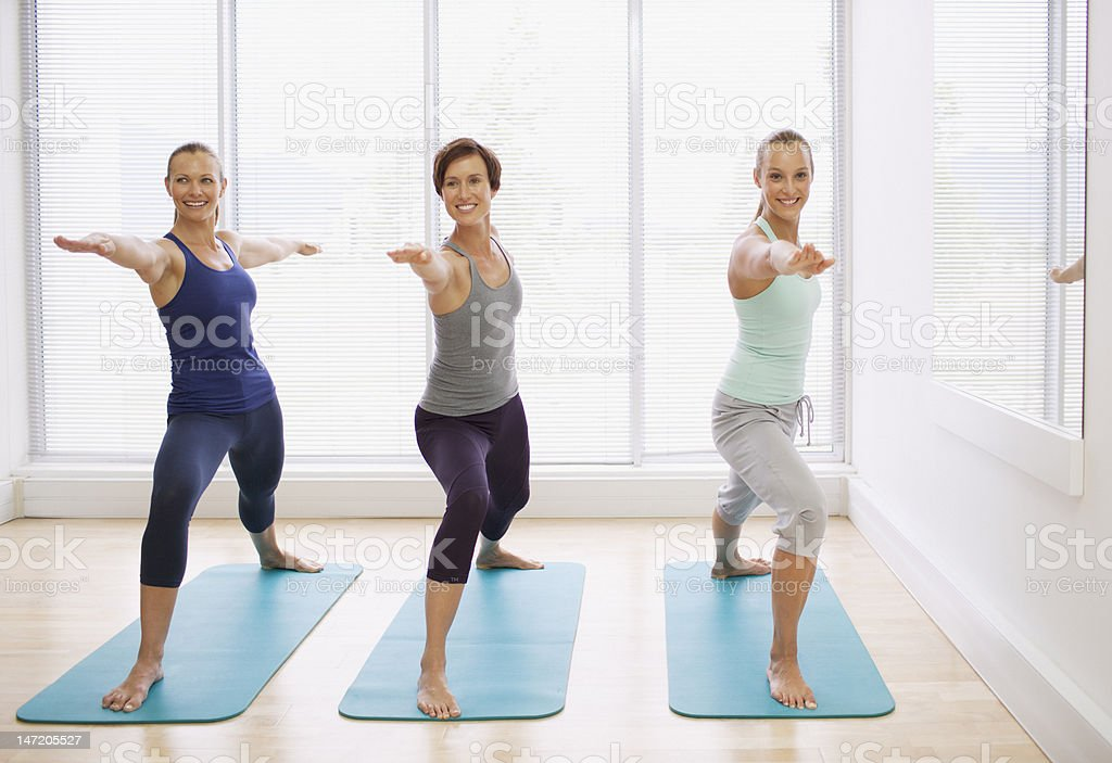 Portrait of smiling women in yoga class royalty-free stock photo