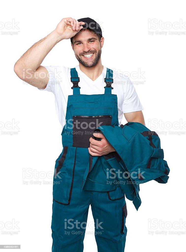 Portrait of smiling worker in green uniform stock photo