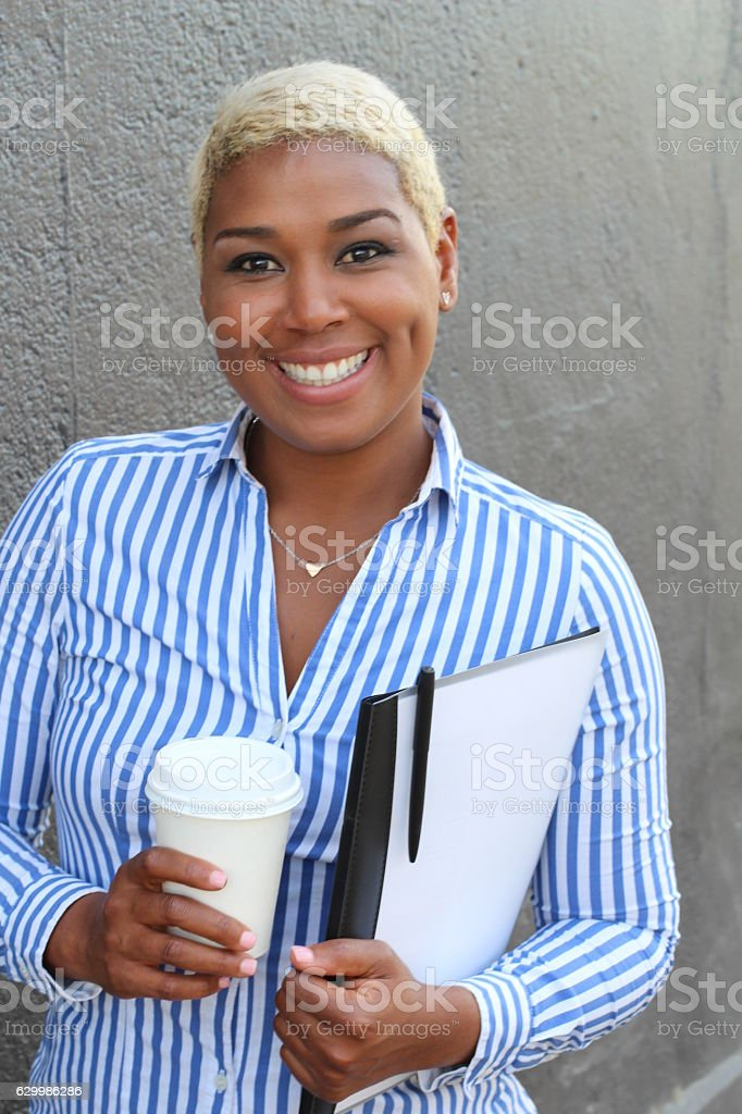 Portrait of smiling young African businesswoman stock photo