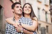 Portrait of smiling young and beautiful couple hugging