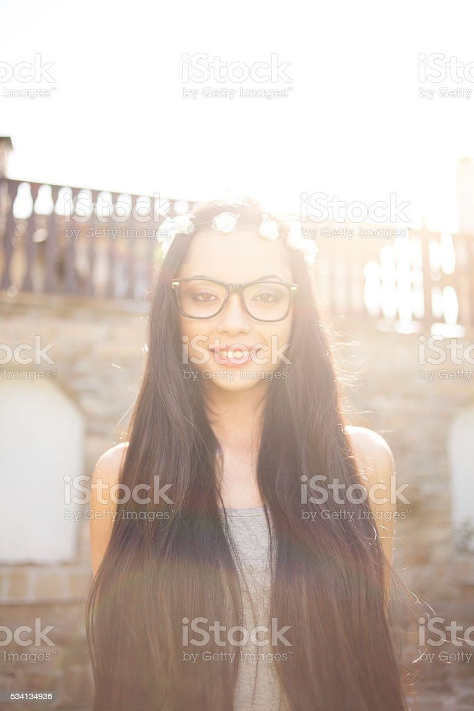 Portrait of smiling young boho woman stock photo