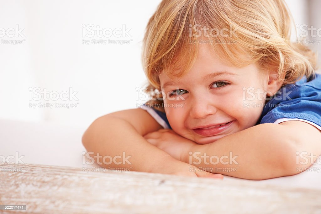 Portrait Of Smiling Young Boy Playing Outside stock photo
