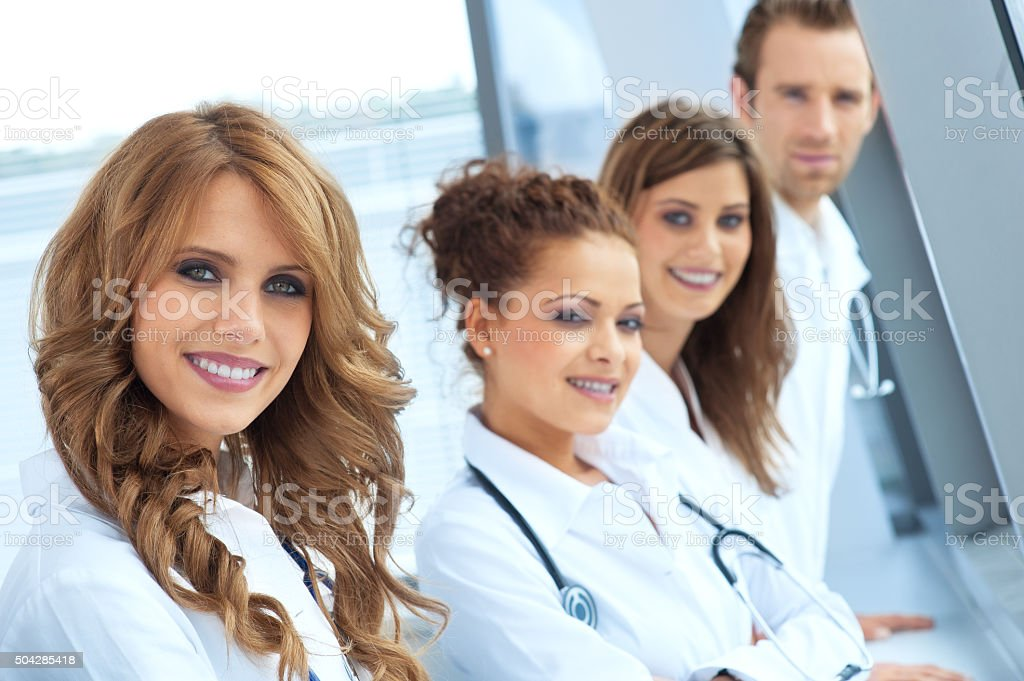 Portrait of smiling young doctors stock photo