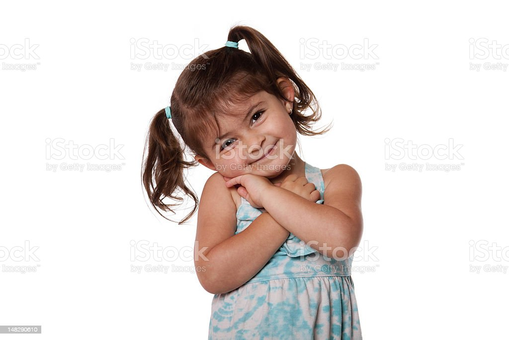 Portrait of smiling young girl in blue dress stock photo