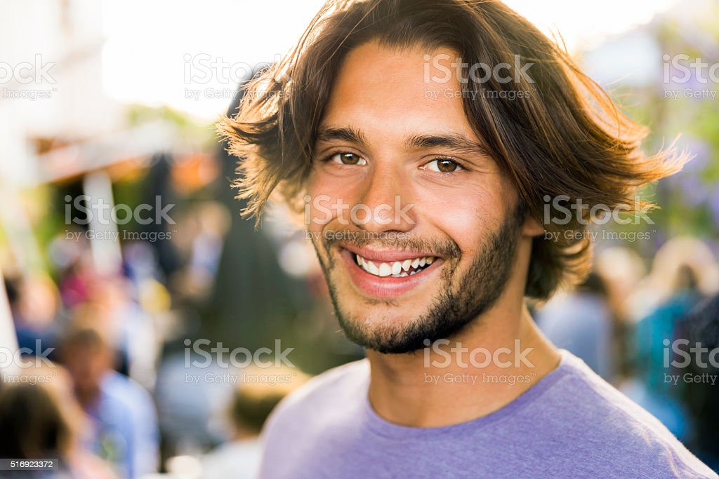 Portrait of smiling young man on vacation stock photo