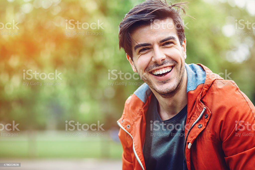 Portrait of smiling young man outdoors stock photo