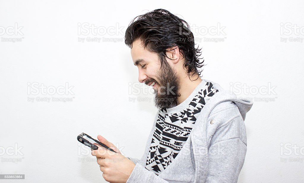 Portrait of smiling young man using digital tablet stock photo