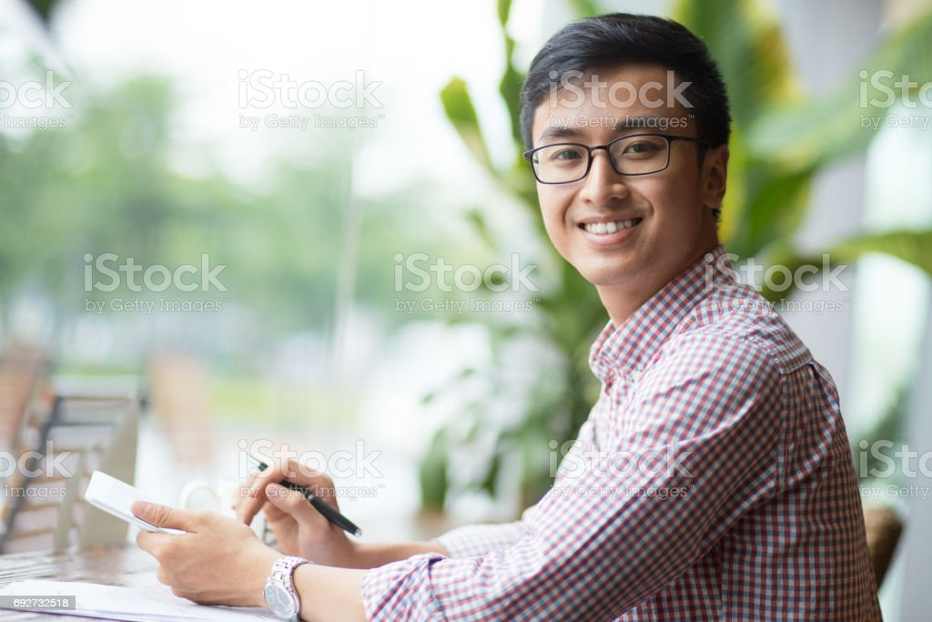 Portrait of smiling young manager with touchpad stock photo