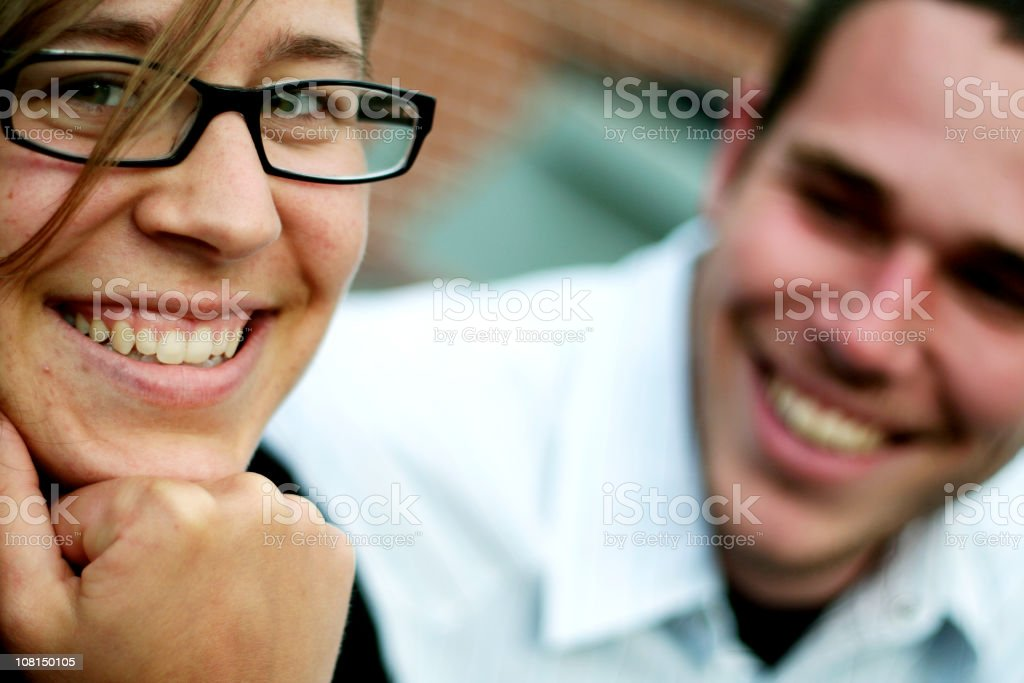 Portrait of Smiling Young Woman and Man royalty-free stock photo