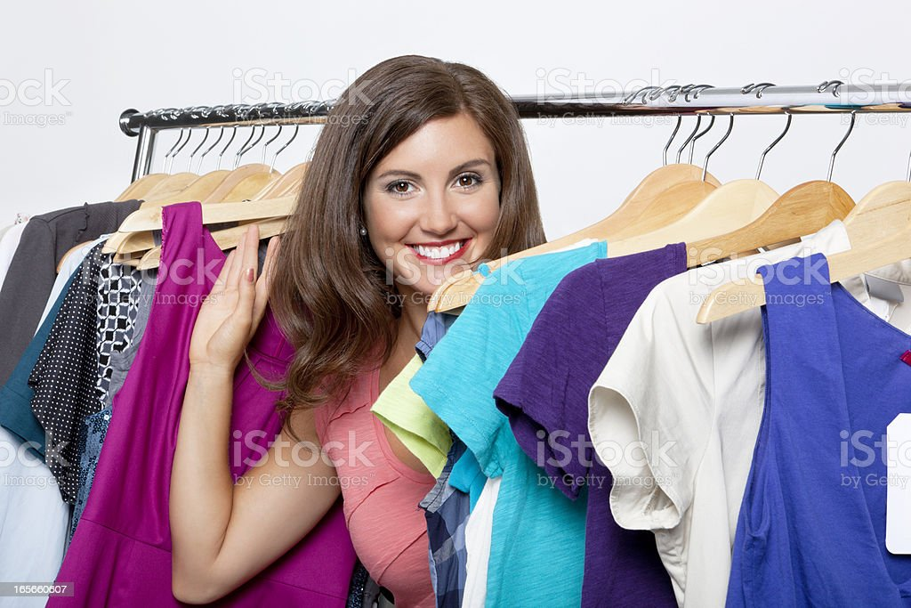 Portrait of smiling young woman at clothing store royalty-free stock photo