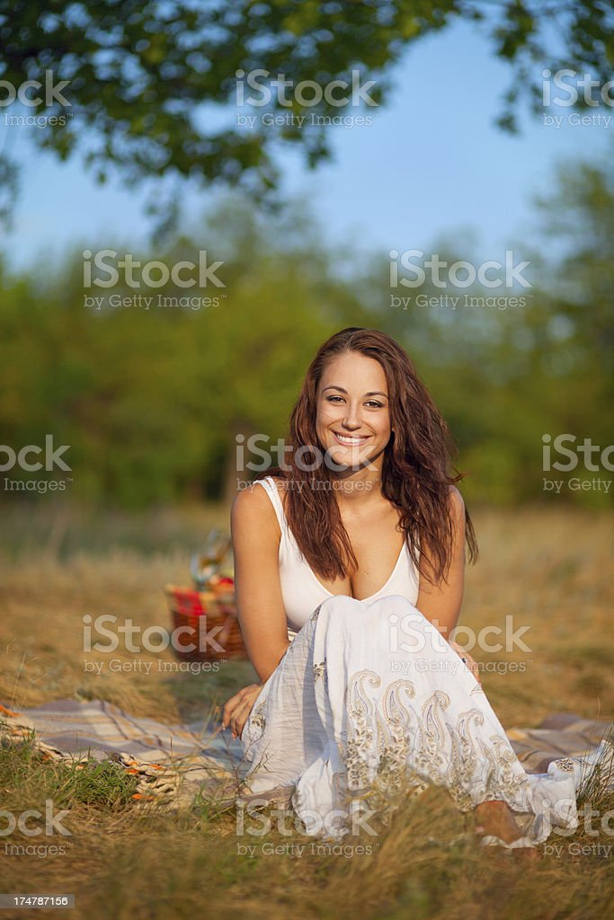 Portrait of smiling young woman at park stock photo